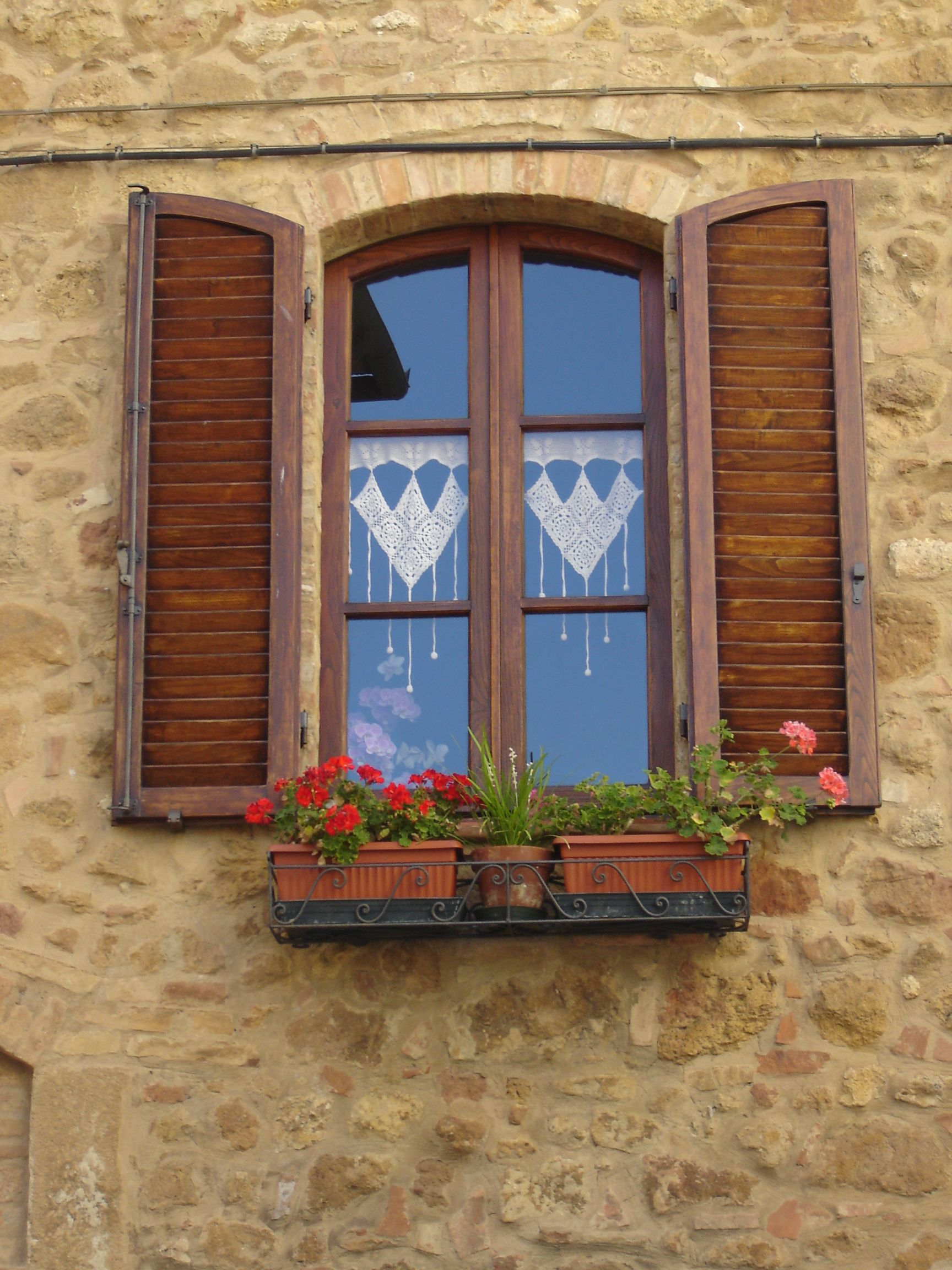 Window in Pienza,province of Siena ,heart shaped lace,Tuscany region Italy