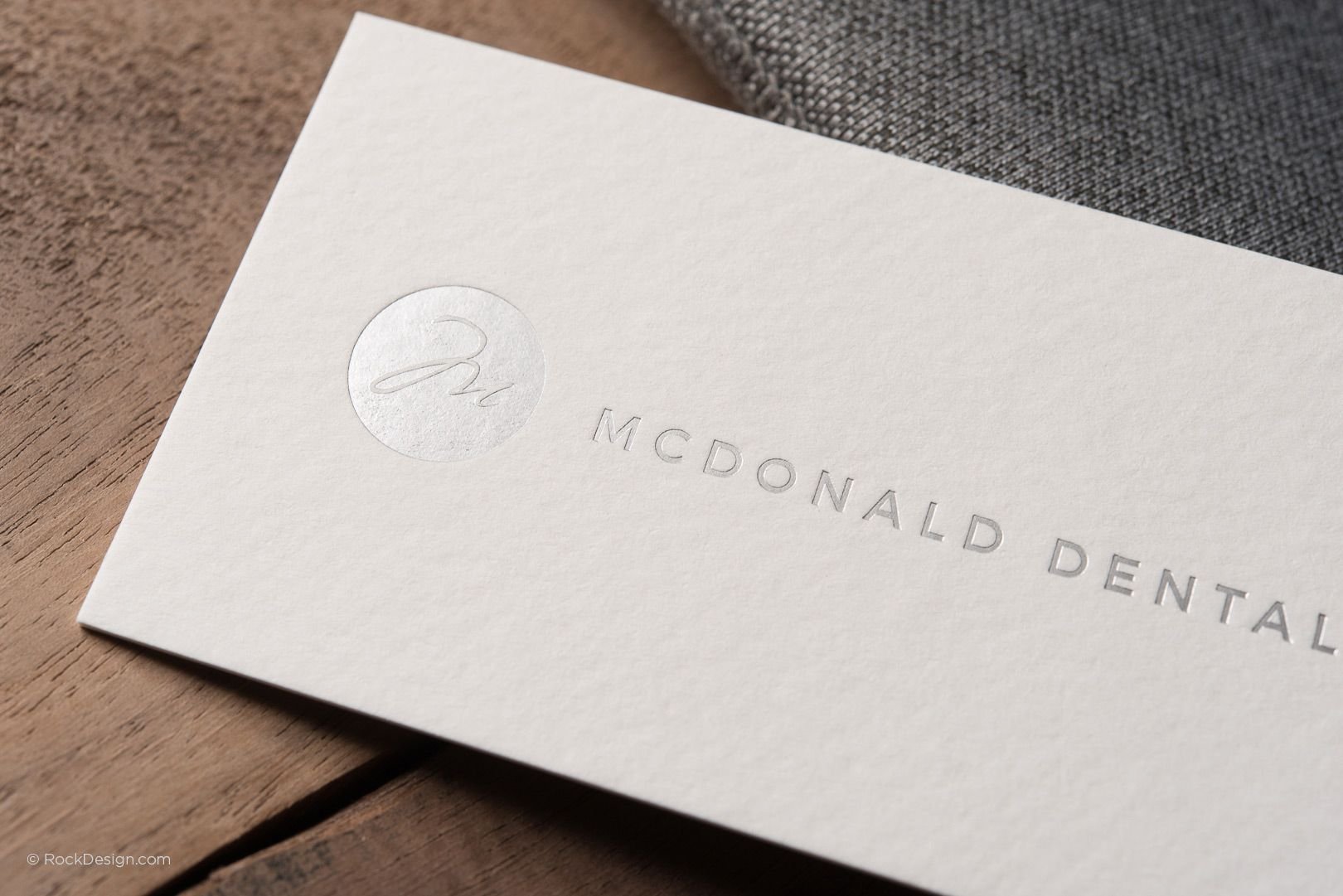 Modern minimalist textured cream business card with silver foil ...