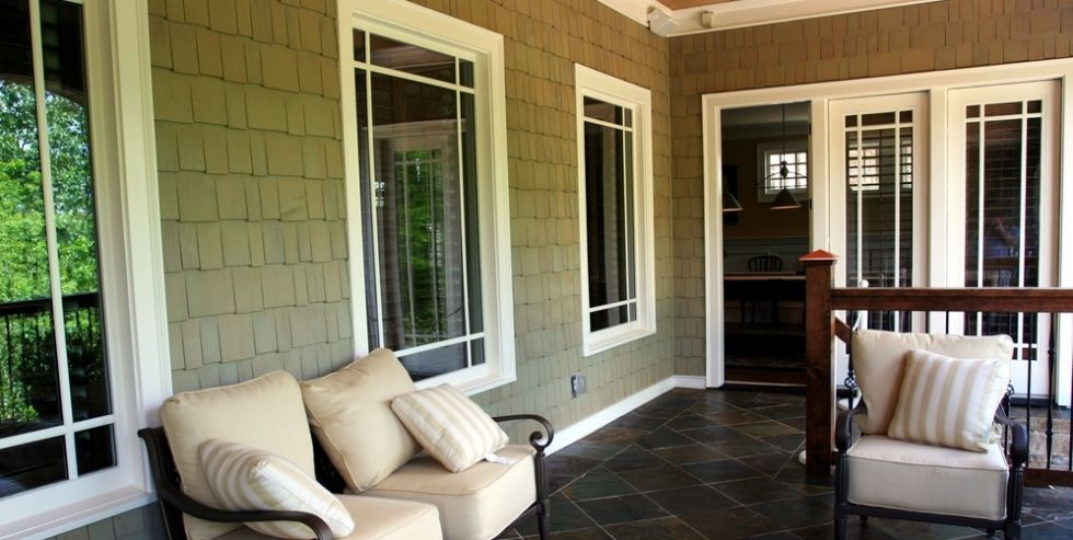 Enjoy the fresh air from under this beautiful covered porch.