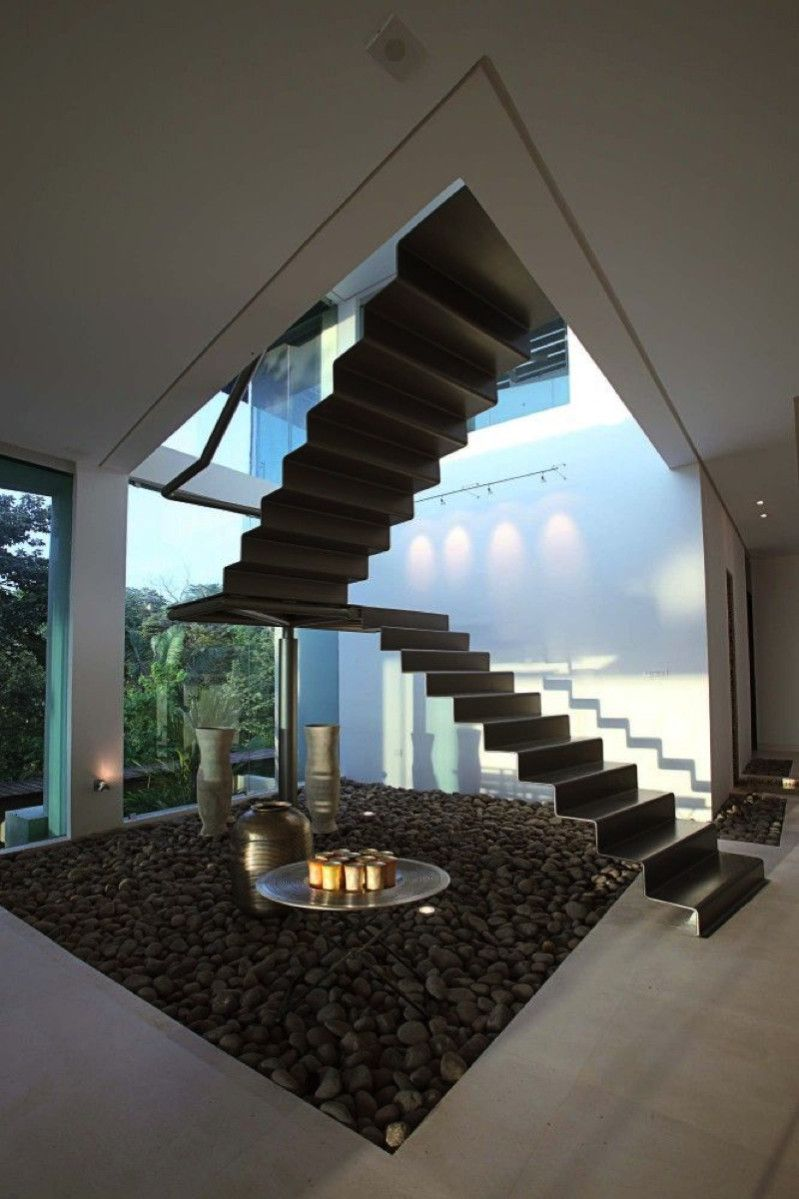 Contemporary single piece steel staircase with landing and return and no balustrade or handrail