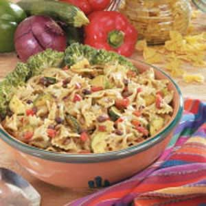 Black Bean Bow Tie Salad Recipe -Even people who don't like beans compliment me on this delicious salad! It's a favorite at family get-togethers and potlucks. The slimmed-down dressing gets little kick from cilantro and lime.                                       —Teresa Smith of Huron, South Dakota