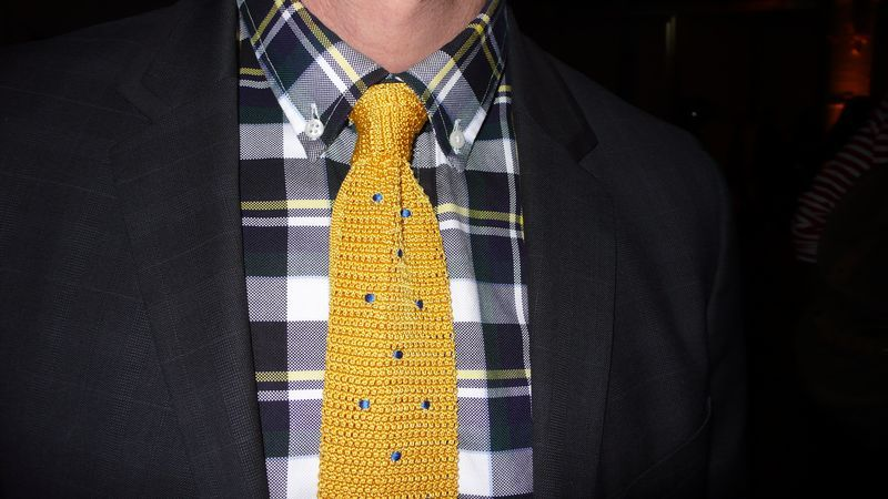 crochet a tie! maybe cheap bright nylon from hardware store?