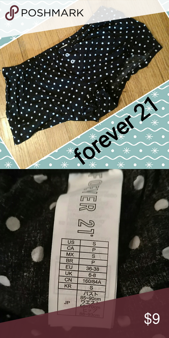 Forever 21 sz small short shorts Cute black shorts w white dots. 2 button front detail. Sz small Forever 21 Shorts