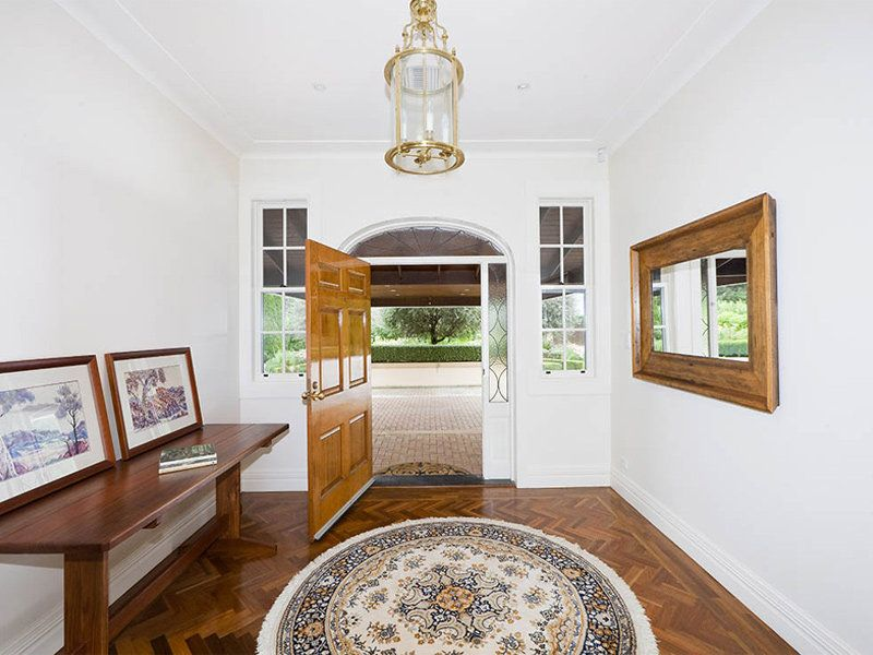 Large Wooden Mirror in Hall way