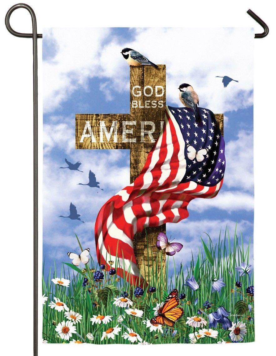 God Bless America Patriotic Themed Garden Flag A Soft Blue Sky With White Fluffy Clouds Serves As The Backdrop Patriotic Garden Flag Cross Flag Garden Flags