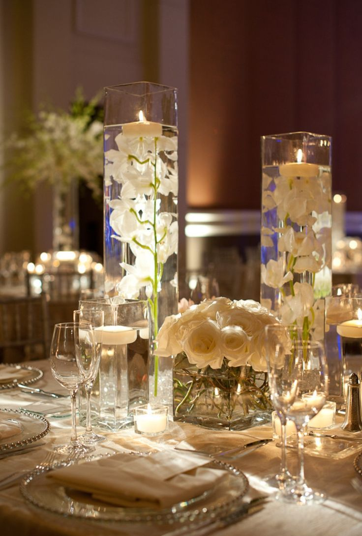 Centerpiece ideas tall class votives with white orchids and a low centerpiece ideas tall class votives with white orchids and a low vase with white roses reviewsmspy