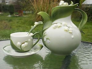 Graff porcelain 'Lily of The Valley' pattern teapot, teacup, saucer and spoon