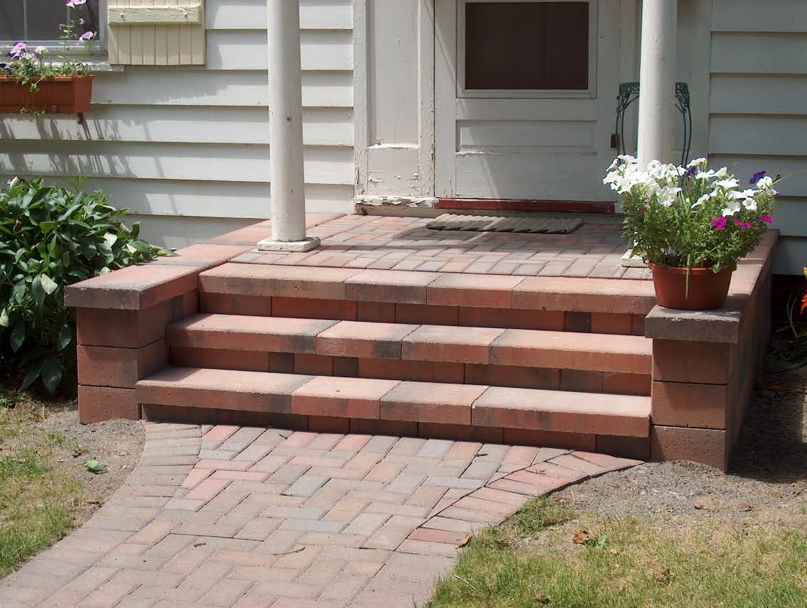 Nice front porch step designs with naturan brick front for Front door patio ideas