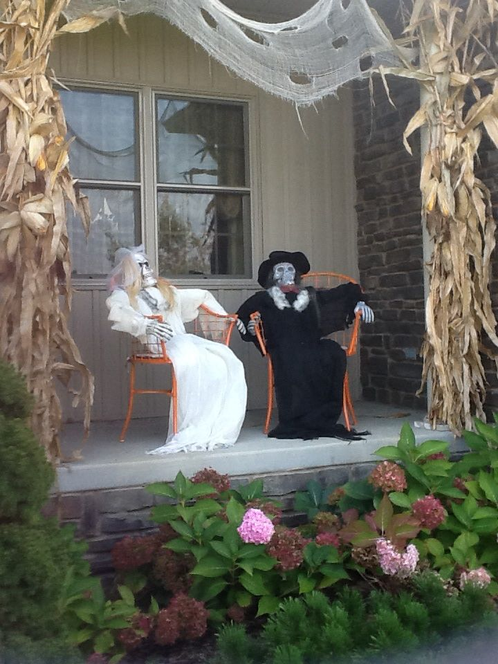 Outdoor Halloween decor...creepy couple...just chillin