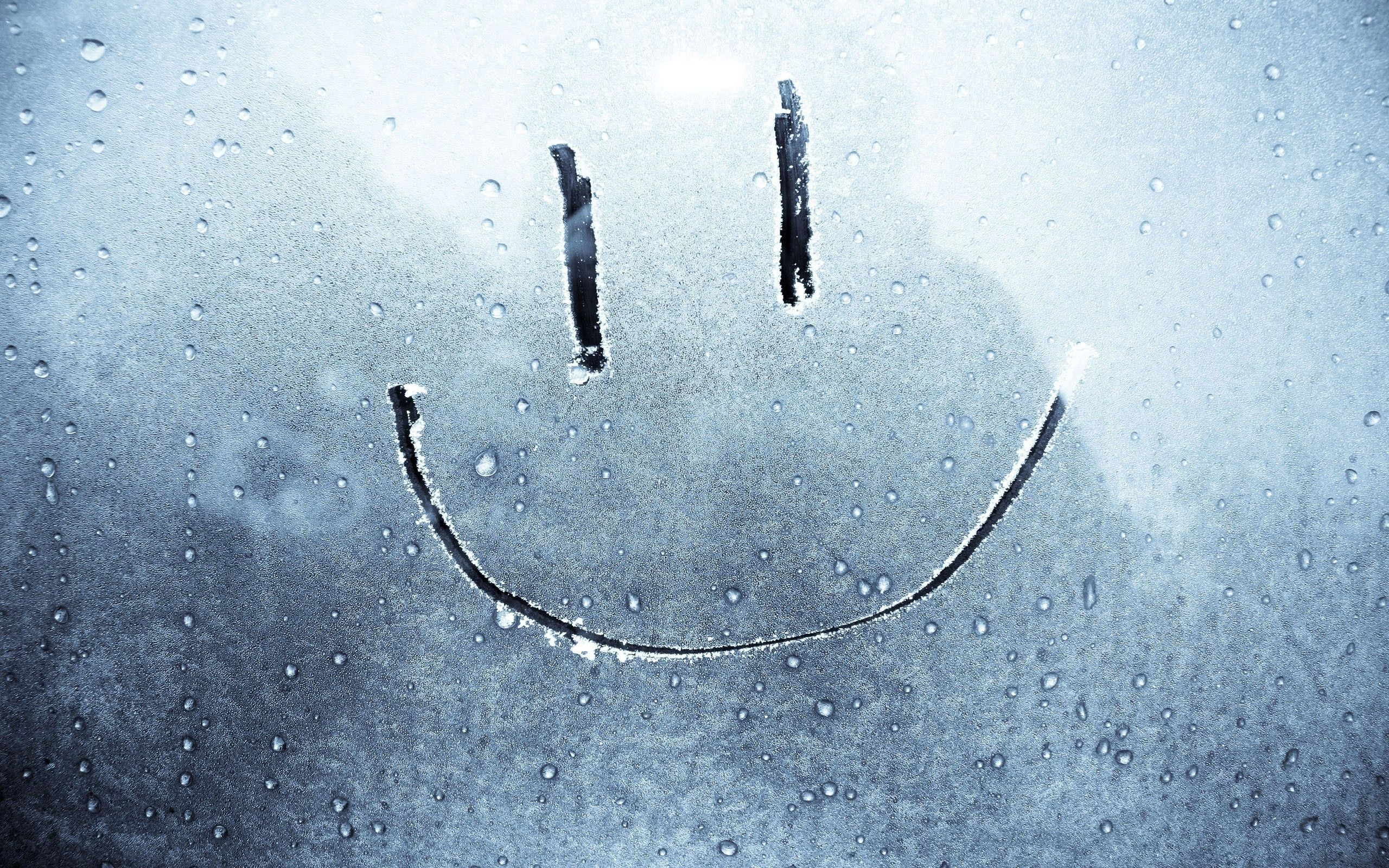 smiley face on a frozen window wallpaper for macbook air