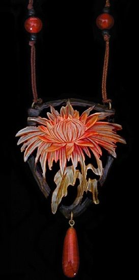 ART NOUVEAU Chrysanthemum Pendant. An engraved horn chrysanthemum pendant with original beads and silk chord. French circa 1900. Unmarked.