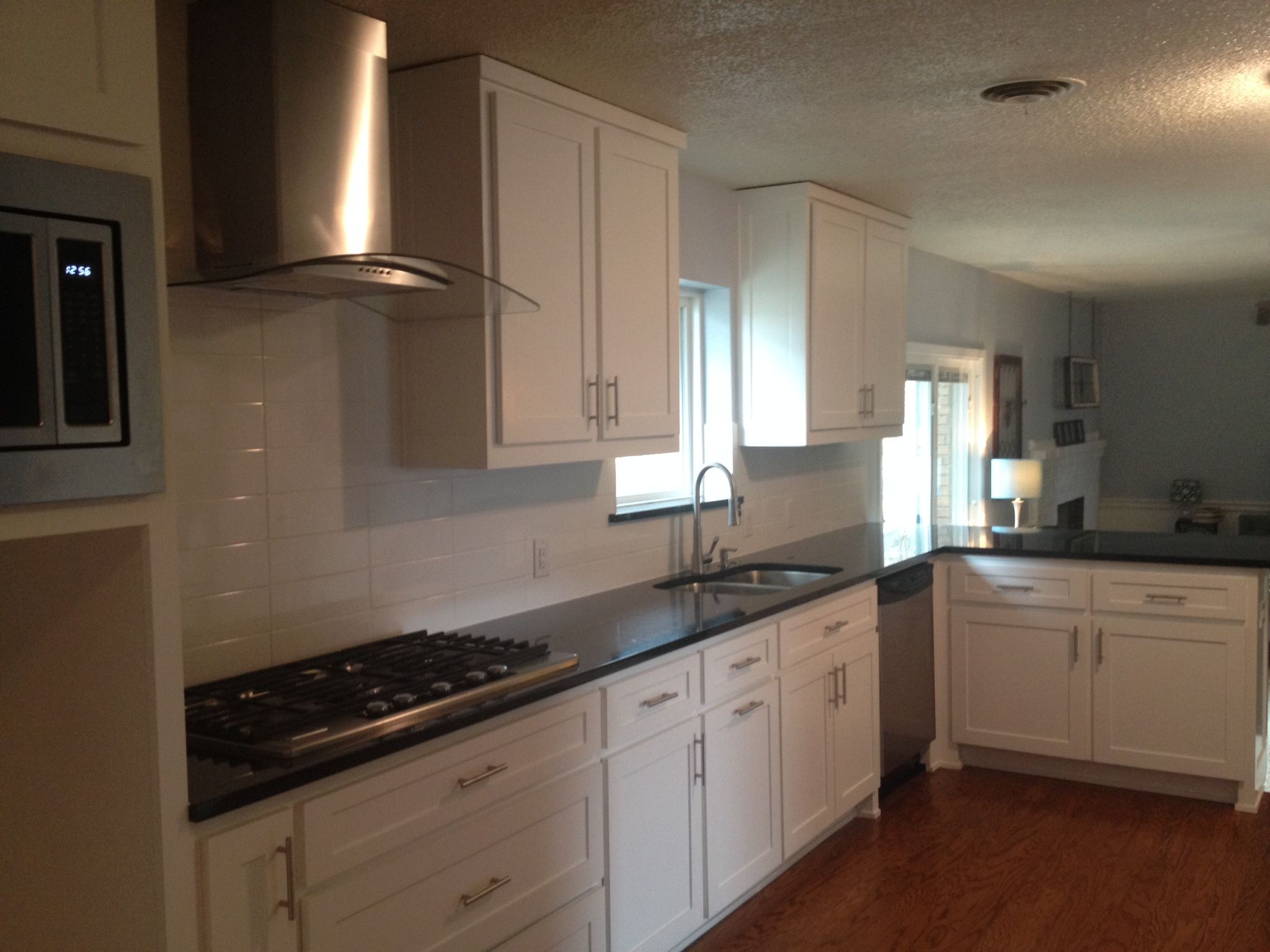 White Shaker Style Cabinets with Absolute Black Granite ...
