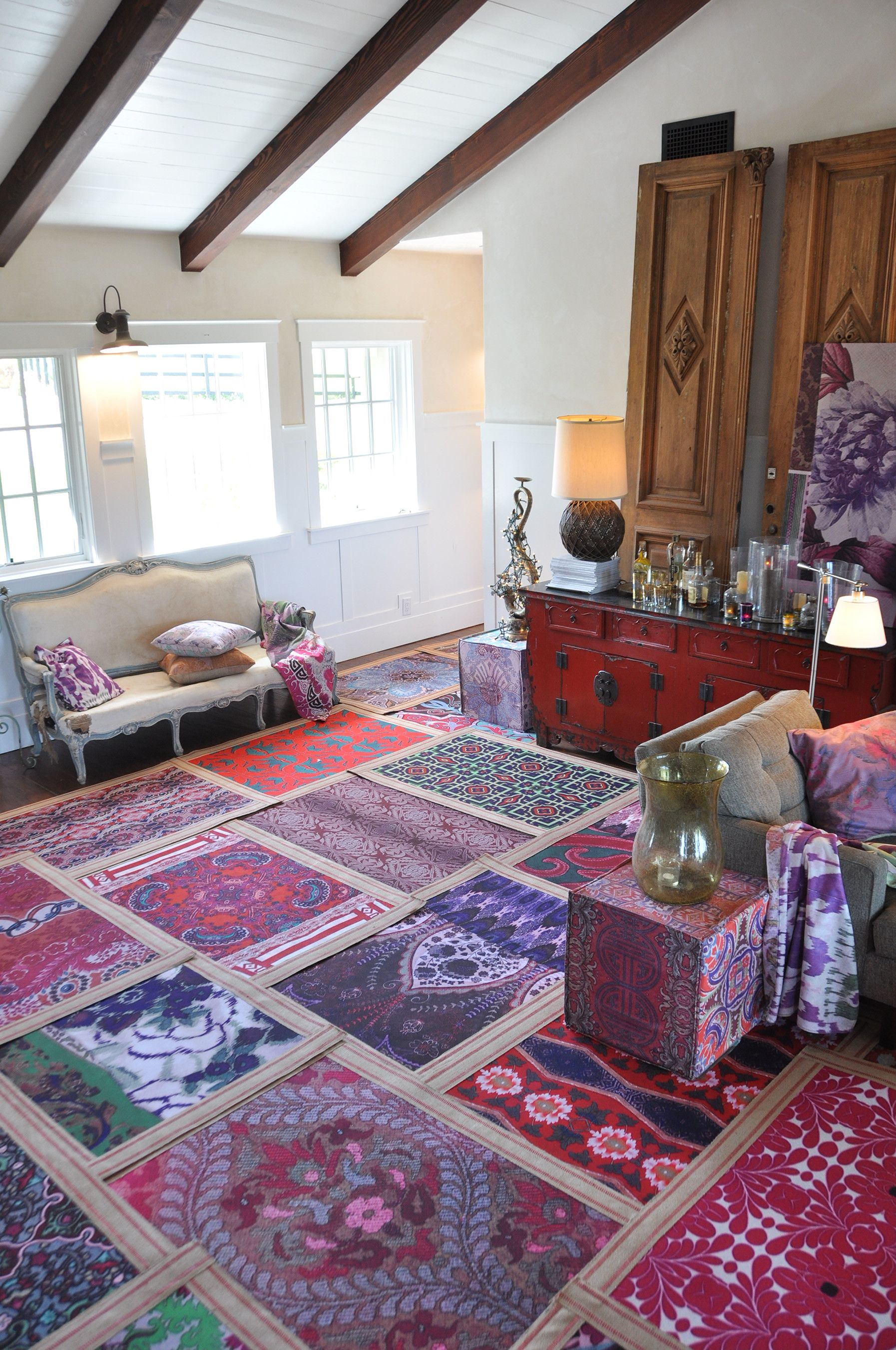 use multiple small area rugs instead of one large one for added
