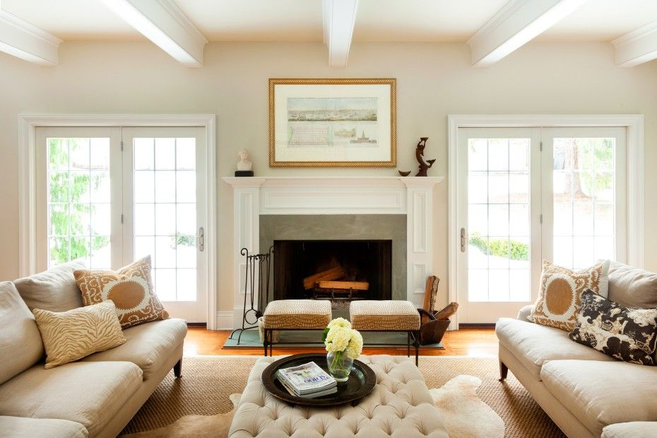 Example Of Two Small Upholstered Stool Ottomans Grouped In Front Of A Fireplace Family Room Family Room Fireplace Den Furniture Layout