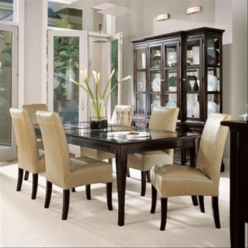 Dining Room Cream Leather Chair Cherry Table Flower Vase White Carpet Curio Cabinet Gl Door Ceramic Plate Green Plant Side Board