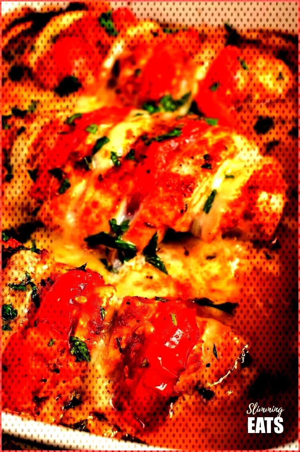 mozzarella hasselback chicken in oven proof dish - - tomato and mozzarella hasselback chicken in ov