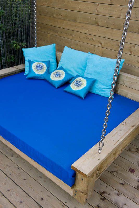 Garden Furniture Essex garden swing seat on pergola hung with chains. garden design in