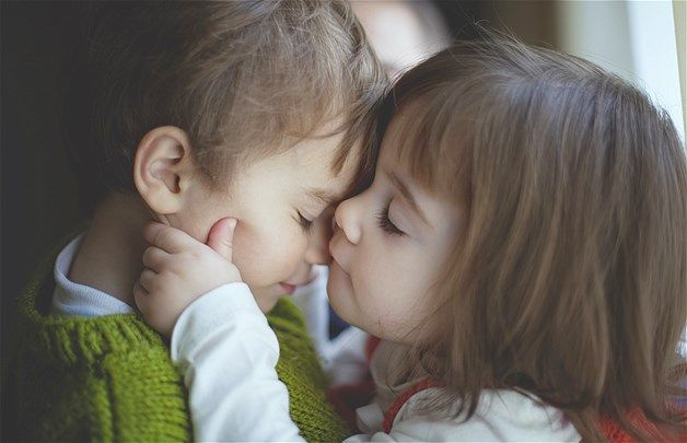 A Little Girl Plants A Kiss On A Little Boy S Nose Image Puppy