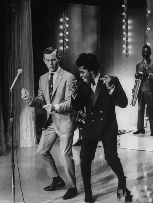 James Brown performs on The Tonite Show, 1967. Johnny Carson, the host of  the Tonite Show joins Brown as he dances. Browns dance moves were unique  and many ...
