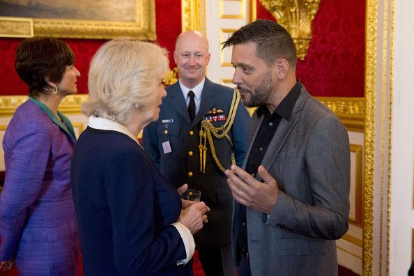 Camilla, Duchess of Cornwall chats with Canadian television host for CBC George Stroumboulopoulos during a reception for Canadians living and working in the UK at St James's Palace on May 14, 2014