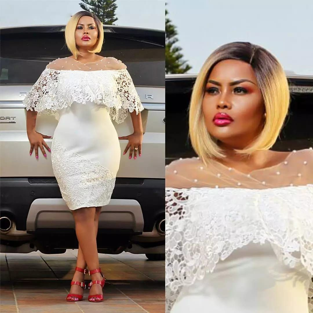 Nana Ama Mcbrown Is A Vision Of Christmas Cheer In White Lace Dress Styles African Fashion Dresses Lace White Dress