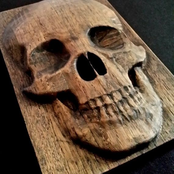 Carved oak skull from antique church pew with ebony stain by