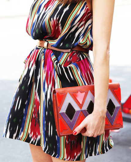 love the geometric clutch with this printed dress