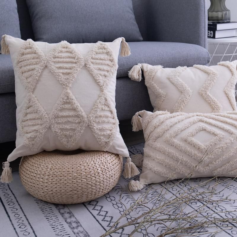 The Lila Tasseled Pillows are a must have for your home! A lovely beige tone with a tufted design on the front of the pillow. This beautiful Moroccan style will lift any couch or bedroom. Details Material: Natural Cotton Handmade Tassel and Tufted Details Three Patterns, Two Sizes Sizes Square 18 x 18 in / 45 x 45 cm Oblong 12 x 20 in / 30 x 50 cm