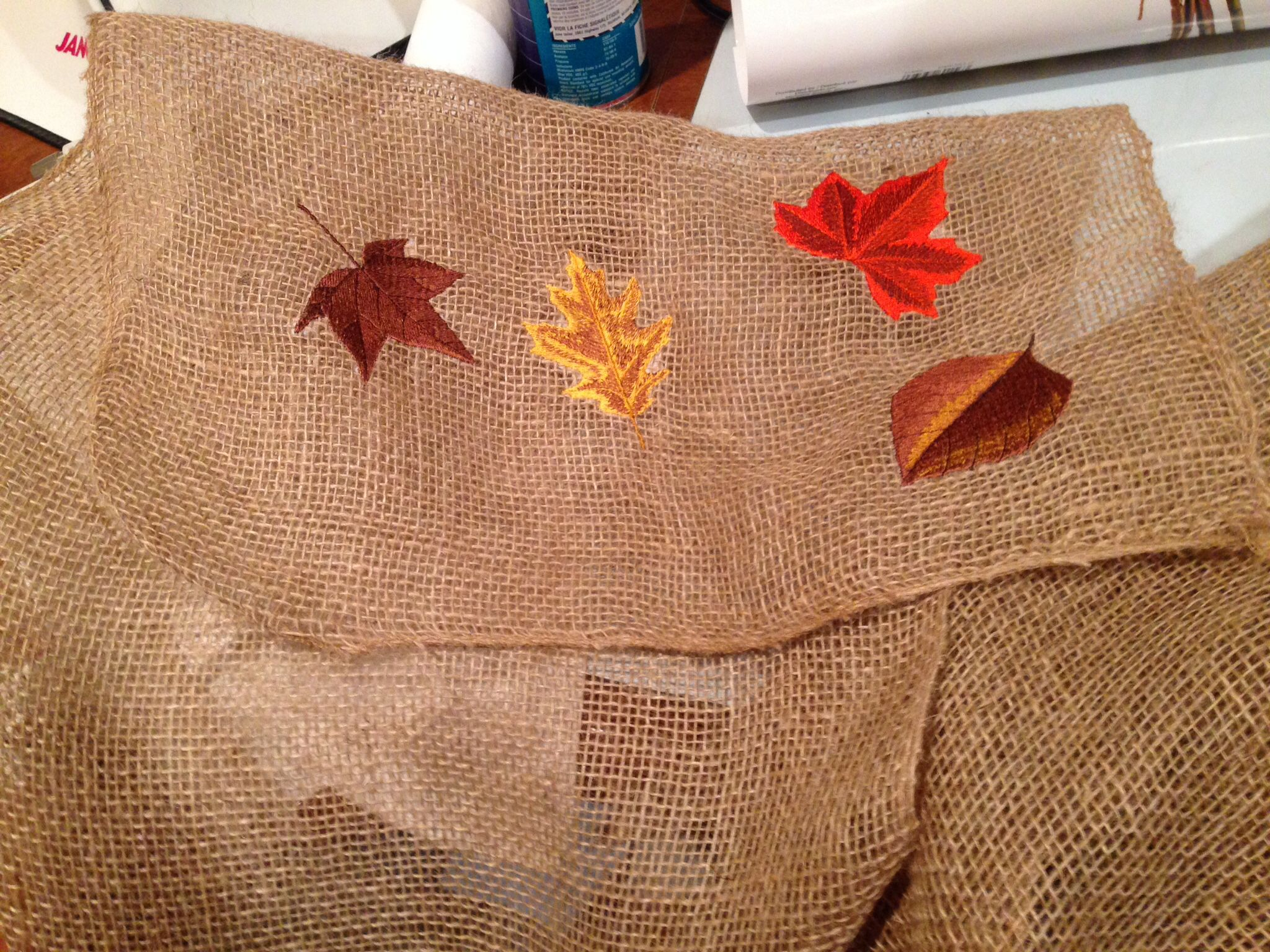 Embroidered table runner from burlap