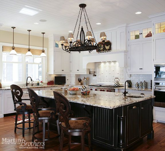 Seating was added to this kitchen island for informal dining or for those who wish to sit & socialize with the cook. Home built by Martin Bros. Contracting, Inc., Goshen, Indiana