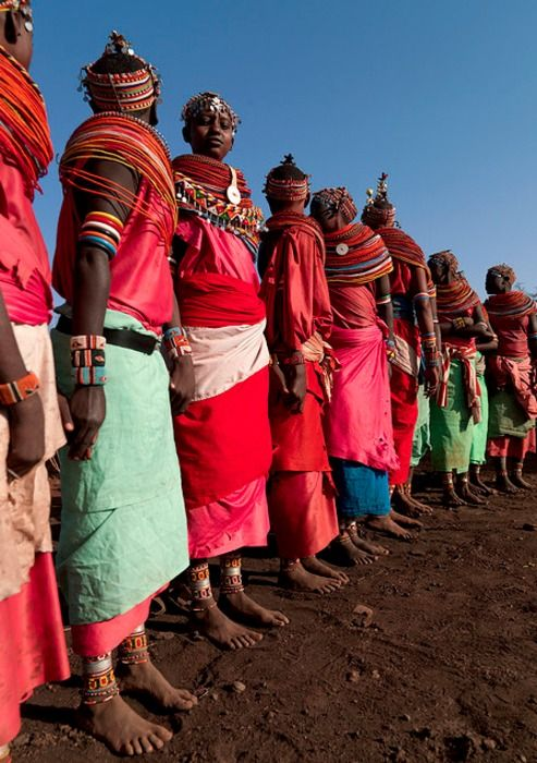 Rendille women with beaded headresses, necklaces and ankle adornments. Kenya