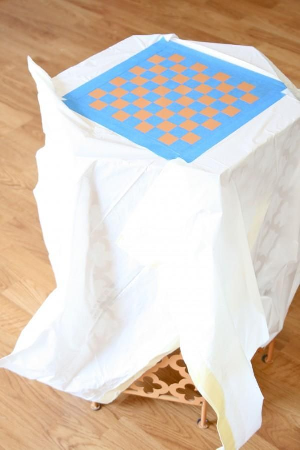 Ready, set, play! See how Carrie of Dream Green DIY painted a DIY checkerboard pattern!