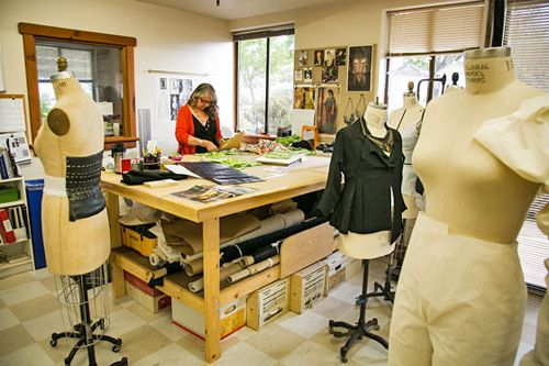 Berkeley Rep costume shop. Cutting table is against one wall, jutting out into room. I prefer this layout: more efficient for the cutter, less chance of bumping stitchers. I also like the bulletin board on wall.