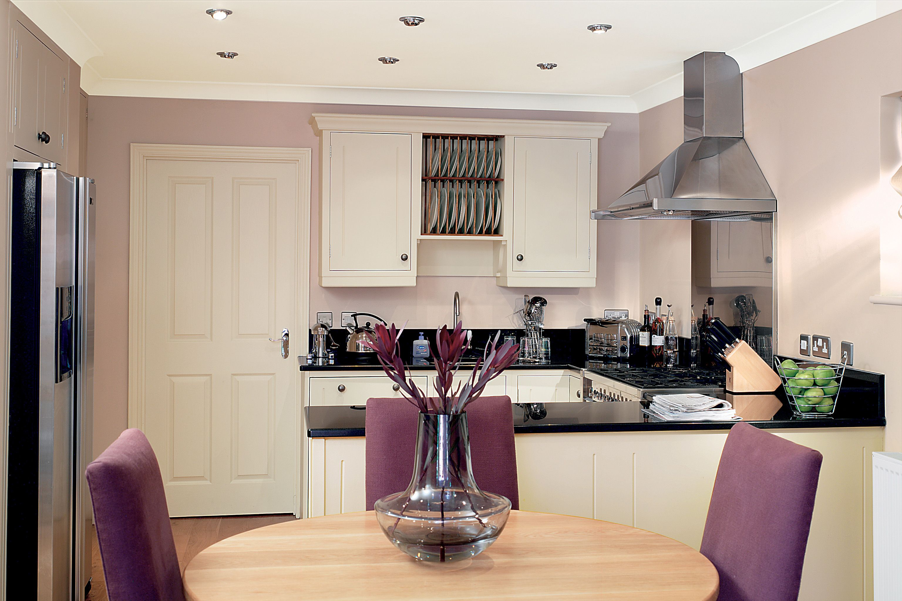 Soft colours compliment a modern stainless steel kitchen