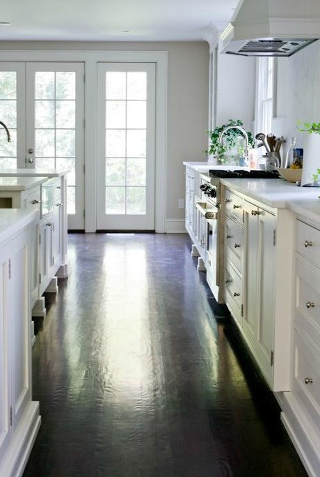 astounding white kitchen cabinets wood floors | Love this! Espresso wood floors with white cabinetry ...