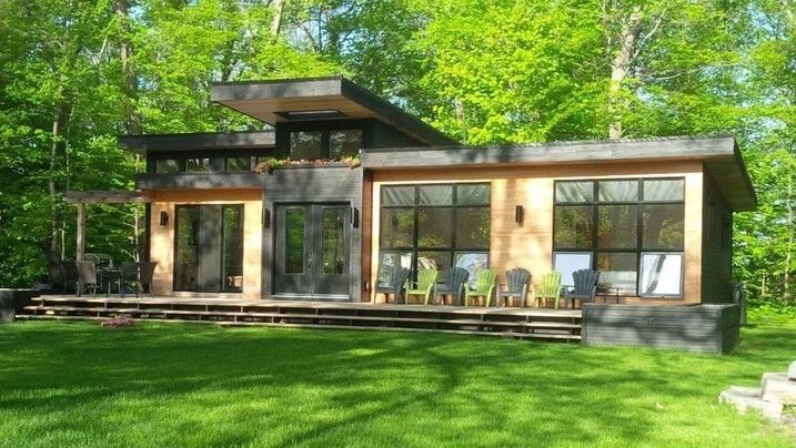 Modern muskoka cottage 400x700 link to real estate for Minimalist cabin design