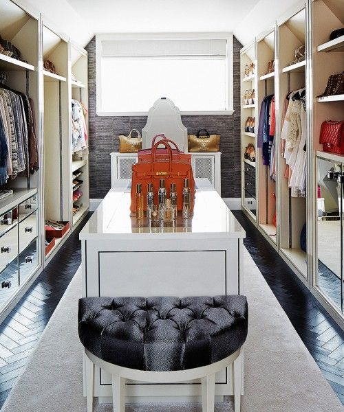 Chic Closet Features A White Island Accented With Black Tufted Half Moon Chair