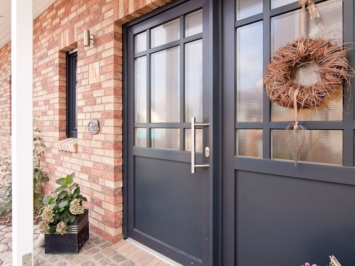 Front doors made of plastic or wood with style elements, such as …