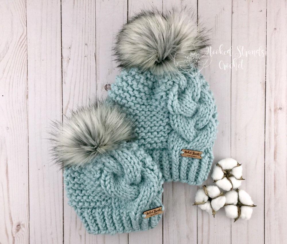 075ec781cf1fad Mommy and me set features a big braid beanie knit hat with a removable faux  fur pom pom. This chunky knit hat is stylish and warm for winter weather.