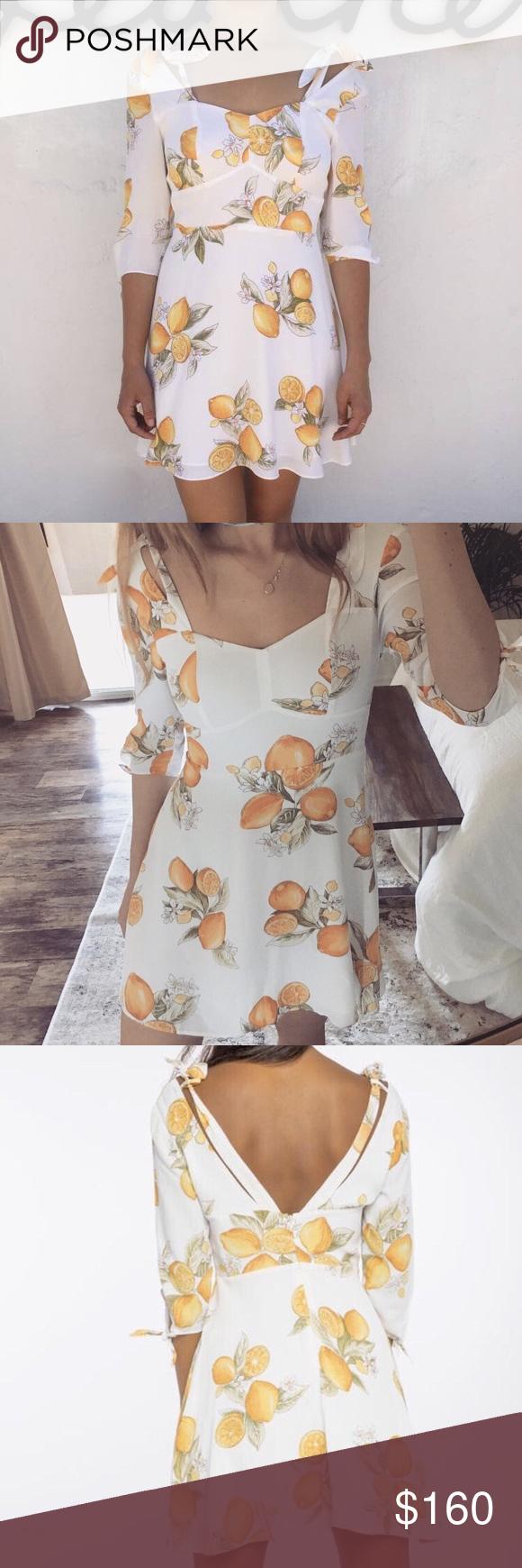 5d20b00b2286 For Love   Lemons Limonada Mini Dress is it! This beautiful dress is a one- of-a-kind lemon print ...