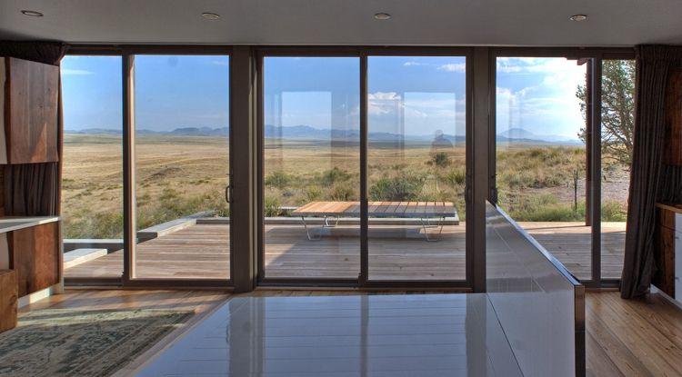 Terrassentüren zum Schieben braun-terrasse-holzdielen-verglasung