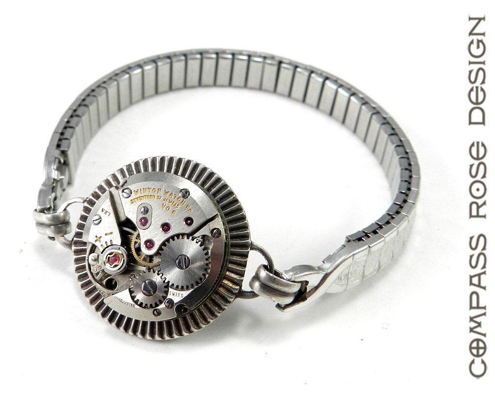 Steampunk Watch Bracelet, Antique Mechanical Watch Bracelet on White Gold Fill Antique Watch Band. $68.50, via Etsy.