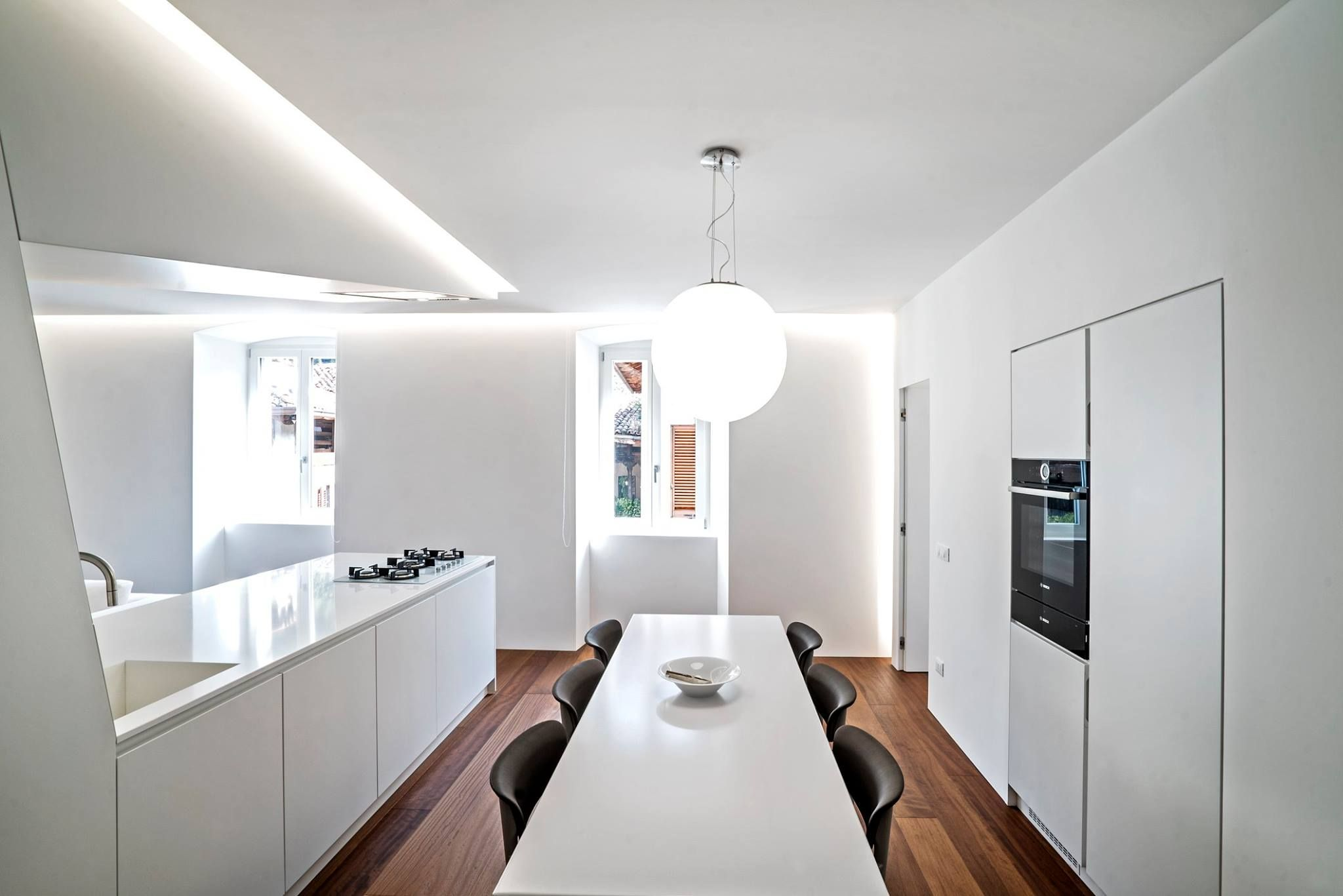 White Modern Apartment Characterized By Asymmetric Furniture