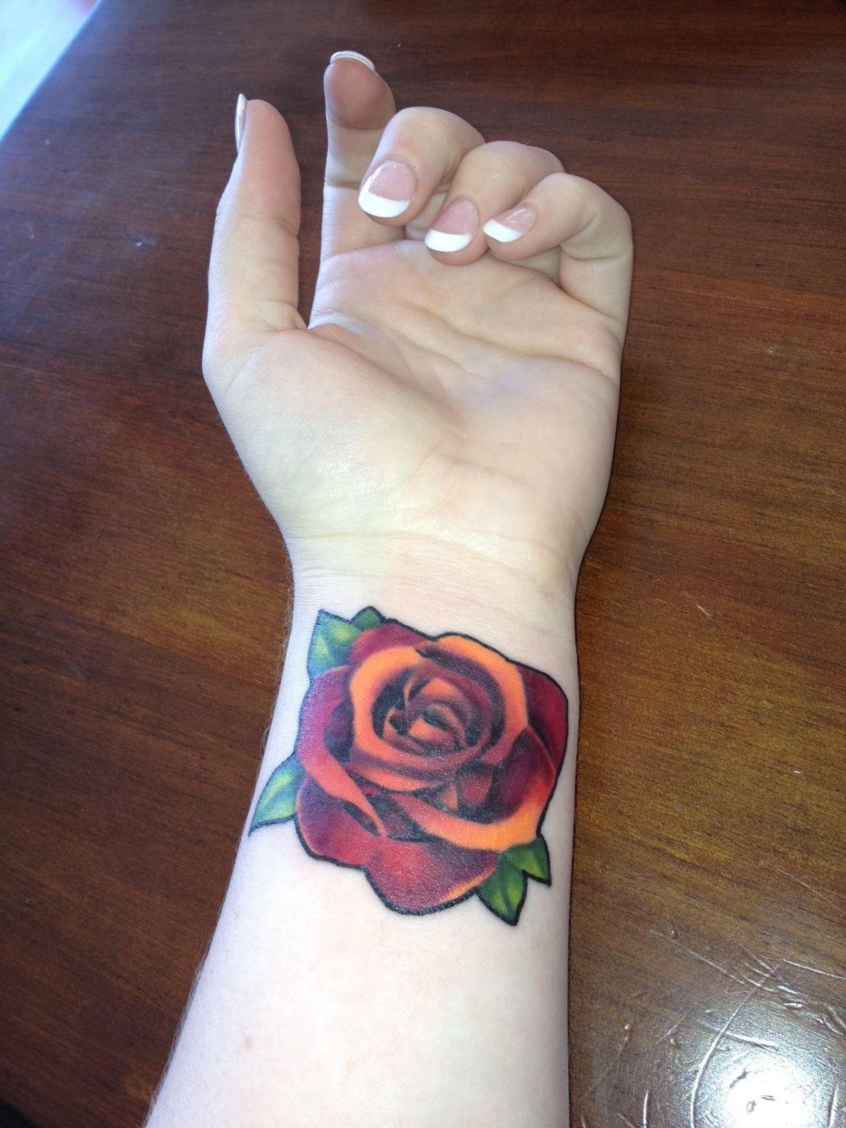 Red/Orange ArtNouveau Rose tattoo by Christina at Zulu