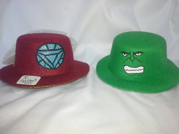 Hand painted mini top hats. This listing is for either an iron man or the hulk themed hat. please indicate which hat you would like. Each hat has 2
