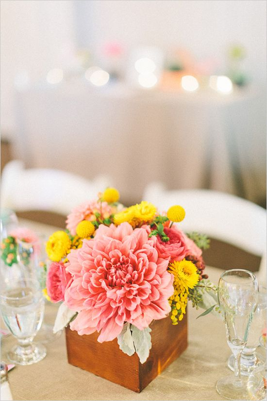 A bright and whimsical wedding table decor for weddings parties pink and yellow wedding floral arrangement mightylinksfo
