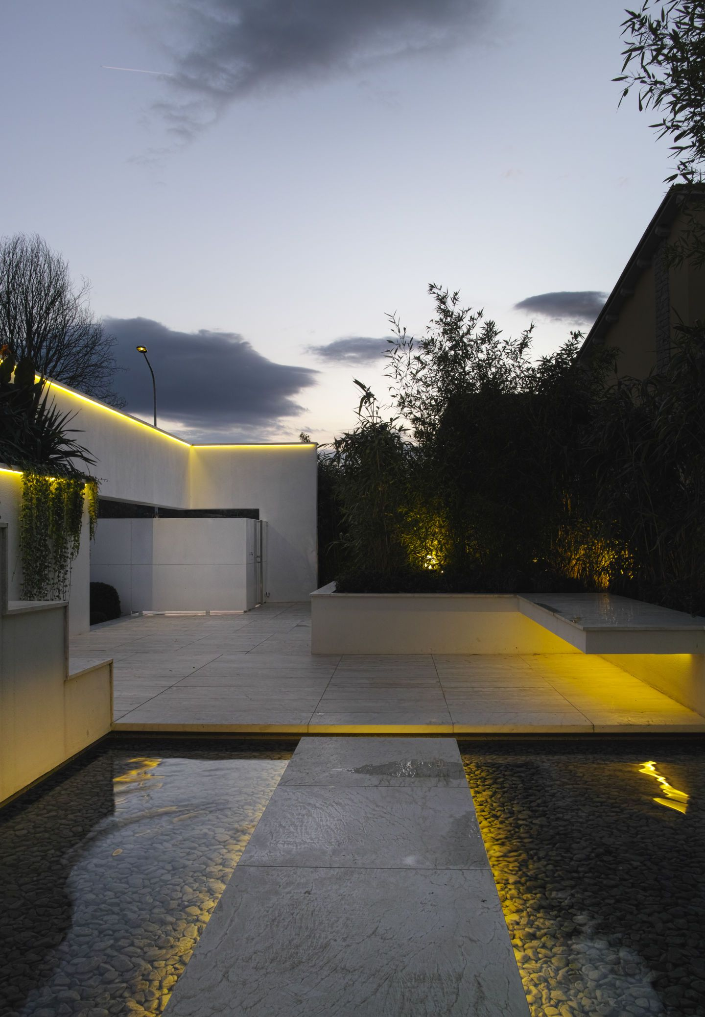 The unit is organized around a patio with the function of ...