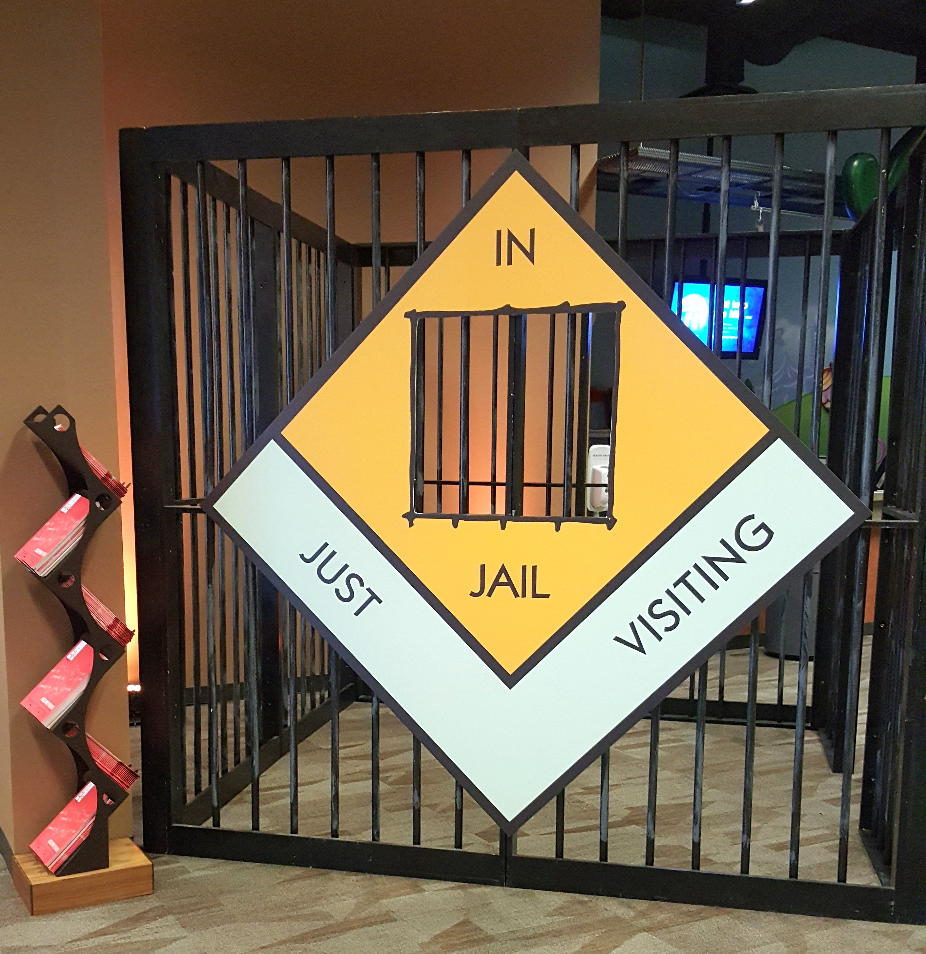 Sign with jail for Monopoly themed event. Monopoly game