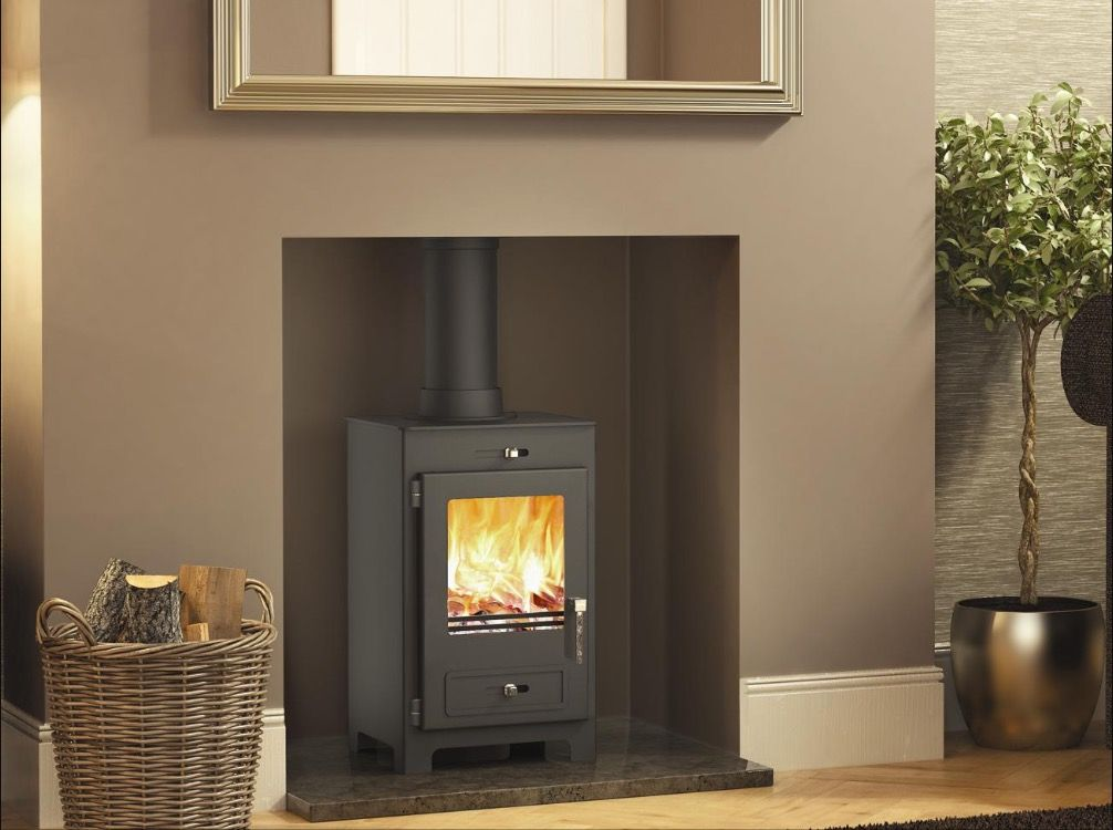 corner wood burning stove with flat space for tv above i would rh pinterest com