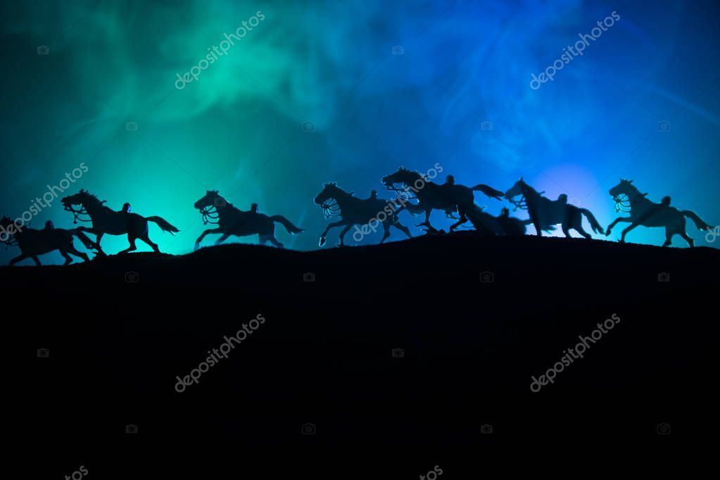 Horse silhouette on the top of a hill against dark toned foggy background Creat